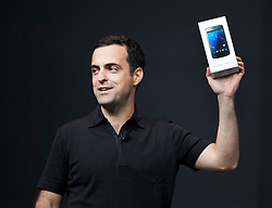 Hugo Barra, product management director of Android, holds up a Samsung Galaxy Nexus at the annual Google I/O developers conference in San Francisco, California.