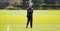 Photo: Chris Ratcliffe.<br /> Arsenal Training Session. UEFA Champions League. 18/04/2006.<br /> Arsene Wenger in reflective mood during training
