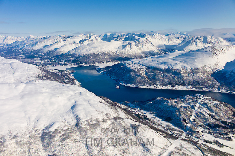 Aerial view of arctic landscape, Ullsfjorden Fjord and the Lyngen Alps from aircraft approaching Tromso in the Arctic Circle in Northern Norway