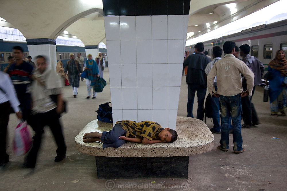 Alamin Hasan sleeps at the Kamalapur Railway Station in Dhaka, Bangladesh, where he works as a porter. (Featured in the book What I Eat: Around the World in 80 Diets.) MODEL RELEASED.