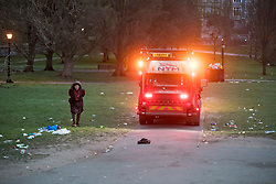 © Licensed to London News Pictures. 05/04/2021. London, UK. A bin lorry passes through litter strewn across the hillside of Primrose Hill in north London, the morning after revellers took to the picturesque location to enjoy the warm spring weather. A relaxation of some lockdown restrictions has gathered larger crowds in many outdoor spaces. Photo credit: Ben Cawthra/LNP