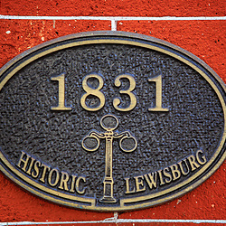 Lewisburg, PA / USA - November 4, 2017: A historic marker sign on a building on Market Street in the downtown area in Lewisburg .