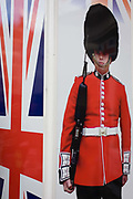 Coldstream guardsman and Union Jack flag appear on a poster outside a tourist shop in central London. Located on a street corner near the British Museum in central London, we see these iconic symbols for Britishness, for the tourism industry and for Britian's Uk identity.