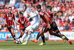 Wayne Rooney of Manchester United is challenged by Andrew Surman and Adam Smith of Bournemouth - Rogan Thomson/JMP - 14/08/2016 - FOOTBALL - Vitality Stadium - Bournemouth, England - Bournemouth v Manchester United - Premier League Opening Weekend.