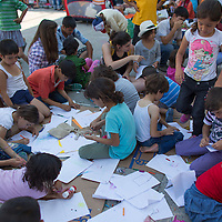 Illegal migrant children draw in a transit zone at the main railway station Keleti in Budapest, Hungary on August 30, 2015. ATTILA VOLGYI