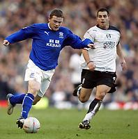 Photo. Aidan Ellis.<br /> Everton v Fulham.<br /> FA Cup 4th Round.<br /> 25/01/2004.<br /> Everton's Wayne Rooney and Fulham's Carlos Bocanegra