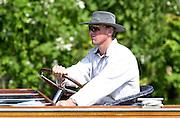 Henley. England. Matt PINSENT, Sydney Gold medallist,  driving a launch at 2001 Henley Women's Henley  Regatta, Henley Reach. United Kingdom. [Mandatory Credit: Peter Spurrier / Intersport Images] 20010623 Women's Henley Regatta.