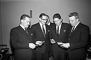 "Presentations at Shell and BP, Fleet Street..1964..18.12.1964..12.18.1964..18th December 1964..At Shell & BP house in Fleet Street, Dublin, the Minister for Justice, Mr Brian Lenihan TD was on hand to present prizes to young winners in ""The Pink Paraffin""competition...Image shows The Minister for Justice, Mr Brian Lenihan TD, and officials from Shell & BP checking the names of the prize winners at the start of the event."