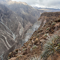 """According to """"Wikipedia"""" - Colca Canyon is a canyon of the Colca River in southern Peru, located about 100 miles (160 kilometers) northwest of Arequipa. It is Peru's third most-visited tourist destination with about 120,000 visitors annually. With a depth of 13,650 ft (4,160 m), it is more than twice as deep as the Grand Canyon in the United States."""