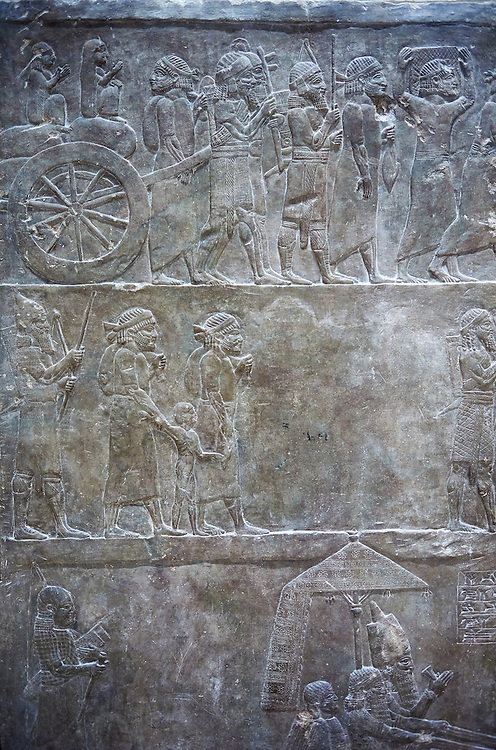Stone relief sculptured panel of prisoners from the campaign of Elam. From the palace of Ashurnasirpal II  room VI/T1, Niniveh, circa 645 BC. inv 19908  Louvre Museum , Paris .<br /> <br /> If you prefer to buy from our ALAMY PHOTO LIBRARY  Collection visit : https://www.alamy.com/portfolio/paul-williams-funkystock/ancient-assyria-antiquities.html  Refine search by adding background colour, place, subject, museum etc into the LOWER SEARCH WITHIN GALLERY box to <br /> <br /> Visit our ANCIENT WORLD PHOTO COLLECTIONS for more photos to download or buy as wall art prints https://funkystock.photoshelter.com/gallery-collection/Ancient-World-Art-Antiquities-Historic-Sites-Pictures-Images-of/C00006u26yqSkDOM