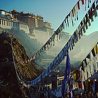 Prayer flags reach toward The Potala, former abode of Dalai Lama in Lhasa, Tibet, China. 1986