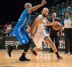 March 20, 2017 - Reno, Nevada, U.S - Reno Bighorn Guard KENDALL MARSHALL (14) drives against Texas Legends Guard CJ WILLIAMS (21) during the NBA D-League Basketball game between the Reno Bighorns and the Texas Legends at the Reno Events Center in Reno, Nevada. (Credit Image: © Jeff Mulvihill via ZUMA Wire)
