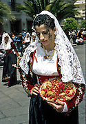 """Cavalcata Sarda, Sassari In Sardinia there are more than 200 festivals and events during the year, but only 3 offer the opportunità to see united, un the same place, all the traditional customs of the isle: Sant'Efisio at Cagliari, the Redentore at Nuoro and the Cavalcata Sarda at Sassari.<br /> The Cavalcata, that is different from the other two celebration because it's not a religious celebration, it join varoius aspects of celebration: there is the presentation of the customs then there is one component more sportive with skills by the riders (""""pariglie""""), elements typically of folk-lore: songs and dances tha last until late hour."""