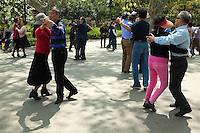 Fuxing Park Dancers, located in the former French Concession of Shanghai, Early morning, the park fills with dancers and  people exercising and practicing  tai chi.