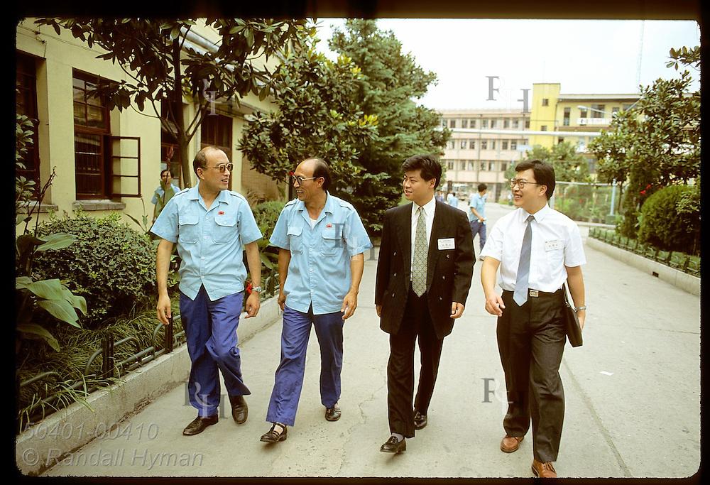 Monsanto rep Sam Chi and salesman Paul Cai Yong talk with mgrs outside fridge factory; Shanghai China