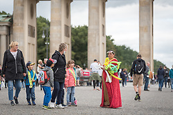 16 September 2021, Berlin, Germany: A Roma woman sells balloons at the  historical site of Brandenburger Tor in Berlin.