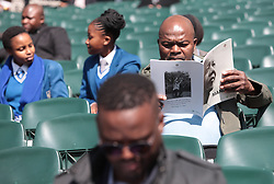17/07/2017 <br /> A man is seen reading the Programme of Nelson Mandela Annual Lecture that will be delievered by the Former President of America Barack Obama at Wanderers Stadium, Johannesburg.<br /> Picture: Nhlanhla Phillips/African News Agency/ANA