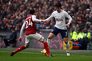 Son Heung-min of Tottenham Hotspur (R) in action with Hector BellerÌn of Arsena (L)l. Premier league match, Tottenham Hotspur v Arsenal at Wembley Stadium in London on Saturday 10th February 2018.<br /> pic by Steffan Bowen, Andrew Orchard sports photography.
