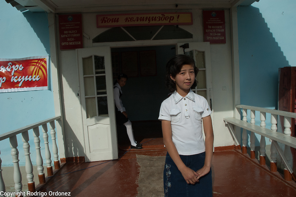 Girls wait for their turn to perform during the ceremony to mark the 'first bell', or first day of school, at School 124 in Osh, Kyrgyzstan.