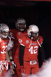 11 December 2015:  Pat Meehan(33), Ryan Gelber(56), and Soniel Estime(42) get ready to take the field as the smoke begins to fill the tunnel.  NCAA FCS Quarter Final Football Playoff game between Richmond Spiders and Illinois State Redbirds at Hancock Stadium in Normal IL (Photo by Alan Look)
