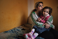 "Denisa Bandyová sits with her daughter Samantha Bandyová, 4, inside their home in Ostrava, Czech Republic on March 2, 2012. Denisa was one of 18 Roma children who were represented in the D.H. and Others v. Czech Republic case, the first challenge to systemic racial segregation in education to reach the European Court of Human Rights. When this case was first brought in 2000, Roma children in the Czech Republic were 27 times more likely to be placed in ""special schools,"" intended for the mentally disabled, than non-Roma children. In 2007, the Grand Chamber of the European Court of Human Rights ruled that this pattern of segregation violated nondiscrimination protections in the European Convention on Human Rights. Despite this landmark decision, little change has occurred: the ""special schools"" have been renamed but follow the same substandard curriculum and Roma continue to be assigned to these schools in disproportionate numbers. The process of integration has barely begun."
