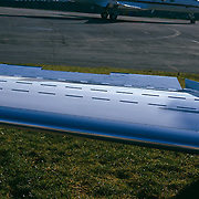 Close-up of a airplane wing lying on ground
