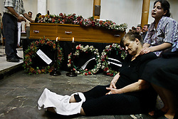 Family members mourn the loss of loved ones  in Baghdad, Iraq on Aug. 20, 2003. The previous day, a family member who was a taxi driver was waiting for UN officials outside the building when a cement truck packed with explosives detonated outside the offices of the UN headquarters in Baghdad, Iraq, killing 20 people and devastating the facility in an unprecedented suicide attack against the world body. At least 100 people were wounded.