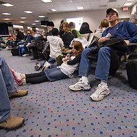 Travelers wait for a flight at New York City's La Guadia Airpot.