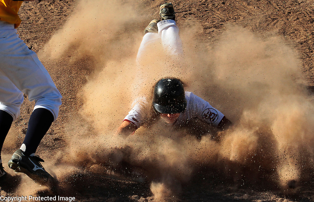 San Lorenzo Valley's Patrick Primeau gets a face full of dust as he steals third base in the seventh inning of SLV's 9-inning victory over Soquel.<br /> Photo by Shmuel Thaler <br /> shmuel_thaler@yahoo.com www.shmuelthaler.com