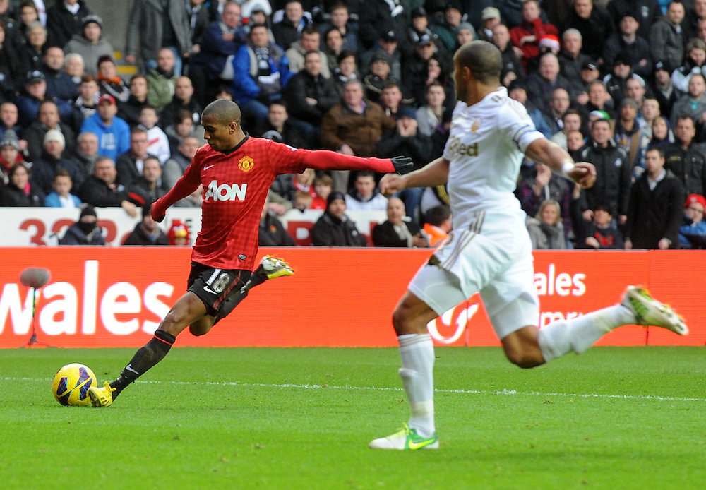 Manchester United's Ashley Young lines up a shot at goal ..Football - Barclays Premiership - Swansea City v Manchester United - Sunday 23rd December 2012 - The Liberty Stadium - Swansea..