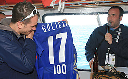 Jurij Golicic and Jure Mastnak at whale watching boat when Poloncic (18), Golicic (17), Rebolj (27) and Razingar (9) were celebrating an anniversary of playing for Slovenian National Team for 100 (120) times, during IIHF WC 2008 in Halifax,  on May 07, 2008, sea at Halifax, Nova Scotia,Canada.(Photo by Vid Ponikvar / Sportal Images)