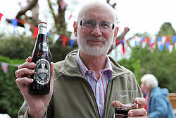 © Licensed to London News Pictures. 04/06/2012. Reading, Berkshire. Malcolm Pemble, 62 with his Silver Jubilee Guiness bottle saved especially for The Queen's Diamond Jubilee garden party. Photo credit : Rebecca Mckevitt/LNP