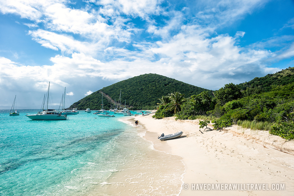 White Bay on Jost Van Dyke in the British Virgin Islands. The beach is famous for a string of bars serving tropical drinks, most famously the Soggy Dollar Bar.