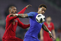 (L-R) Manuel Fernandes of Portugal, Memphis Depay of Holland during the International friendly match match between Portugal and The Netherlands at Stade de Genève on March 26, 2018 in Geneva, Switzerland
