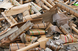 Pile of cardboard waste to be sorted for recycling,