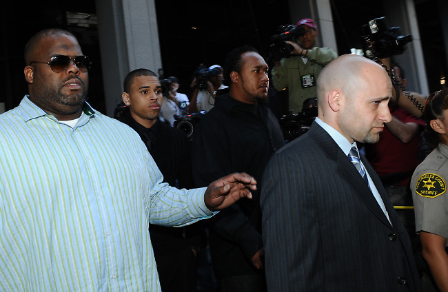 Singer Chris Brown leaves the Los Angeles Superior Court for his arraignment for the alleged assault of his girlfriend Rihanna, in Los Angeles, CA, USA on April 6, 2009. Brown is charged with felony counts of assault and making criminal threats. Photo by Lionel Hahn/ABACAPRESS.COM  | 183665_002 Los Angeles