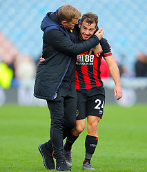 Bournemouth manager Eddie Howe (left) and Bournemouth's Ryan Fraser celebrate after the final whistle of the Premier League match at the John Smith's Stadium, Huddersfield.