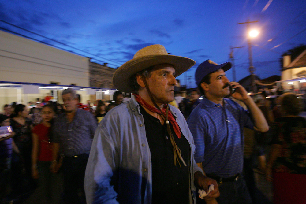 Jay Johnson Castro navigates the crowds of Roma's annual festival with Angel Alaniz, at right.