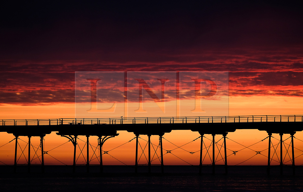 © Licensed to London News Pictures. <br /> 20/09/2017 <br /> Saltburn by the Sea, UK.  <br /> <br /> A brief but dramatic sky is lit up over the pier at Saltburn by the Sea as the sun begins to rise.<br /> <br /> Photo credit: Ian Forsyth/LNP