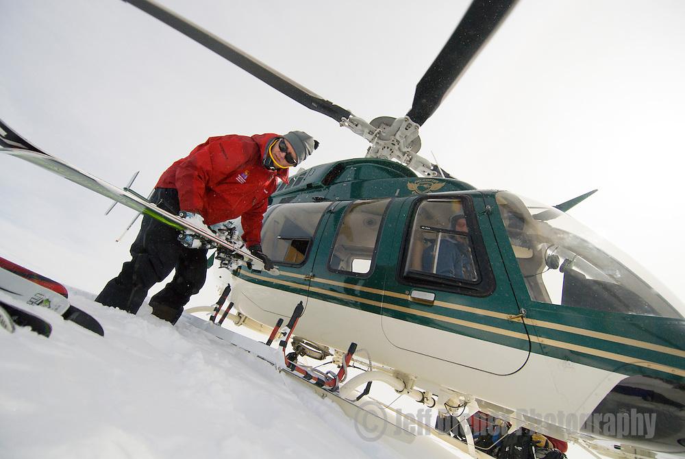 Jon Shick unloads the heli for High Mountain Heli Skiing in Jackson Hole, Wyoming.