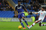 Cardiff City's Sammy Ameobi (l) takes on M K Dons George Baldock. Skybet football league championship match, Cardiff city v MK Dons at the Cardiff city stadium in Cardiff, South Wales on Saturday 6th February 2016.<br /> pic by Carl Robertson, Andrew Orchard sports photography.