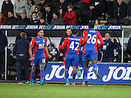 Wilfried Zaha of Crystal Palace celebrates his teams third goal with his teammates, 3-3, during the Premier League match between Swansea City and Crystal Palace at the Liberty Stadium, Swansea, Wales on 26 November 2016. Photo by Andrew Lewis.