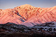 Sunrise over the snow-covered High Atlas Mountains.