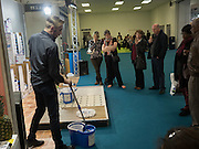 DEMONSTRATING MOP AND BUCKET, Ideal Home Show, sponsored by Zoopla, Olympia. London. 19 March 2016