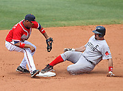 ATLANTA - JUNE 28:  Catcher Jason Varitek #33 of the Boston Red Sox slides into second base for a double just under the tag of shortstop Diory Hernandez #27 of the Atlanta Braves during the game at Turner Field on June 28, 2009 in Atlanta, Georgia.  The Braves beat the Red Sox 2-1.  (Photo by Mike Zarrilli/Getty Images)