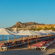 Beach chairs and umbrellas at El Medano beach. Cabo San Lucas Bay. BCS.