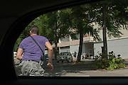 Armed policeman form BAC unit chases a dealer at the beginning of a police raid in the poor neighborhood Font Vert (Marseille). Font Vert is one of the poorest districts in the city, used as a basis for drug trafficking on a large scale. In North Marseille, drug traffic is flourishing, leading to murders among groups of competing dealers. 19 people were shot dead in drugs related killings in 2012, mainly with Kalachnikovs....Policier du BAC armé descend a tout allure d'une voiture banalisé et se lance à la poursuite d'un dealer au début d'une descente de la police dans le quartier pauvre Font Vert (Marseille)..Font Vert est une des cités les plus pauvres dans la ville, utilisée comme une base pour le trafic de drogue à grande échelle. Dans les quartiers du Nord le  trafic de drogue est florissante, conduisant à des reglements de compte par des groupes de dealers concurrents.