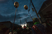 Mikoshi are carried through the night during the Hamaorisai Festival in Chigasaki, Kanagawa, Japan. Monday July 20th 2015. This matsuri is held on Marine Day when Japanese people celebrate their connection to the sea. Forty mikoshi, or portable shrines, are carried to Southern Beach at sunrise where they are blessed and carried into the ocean.