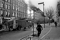 Firemen tackle blaze in Dublin Road, Belfast, N Ireland, following Provisional IRA explosions 6th December 1971. 197112060541a<br /> <br /> Copyright Image from Victor Patterson, 54 Dorchester Park, Belfast, UK, BT9 6RJ<br /> <br /> t1: +44 28 9066 1296 (from Rep of Ireland 048 9066 1296)<br /> t2: +44 28 9002 2446 (from Rep of Ireland 048 9002 2446)<br /> m: +44 7802 353836<br /> <br /> victorpattersonbelfast@gmail.com<br /> victorpatterson@me.com<br /> <br /> www.victorpatterson.com<br /> <br /> Please see my Terms and Conditions of Use at https://www.victorpatterson.com/page2<br /> It is IMPORTANT that you familiarise yourself with them.<br /> <br /> Images used on the Internet incur an additional cost and must be visibly watermarked i.e. © Victor Patterson within the body of the image and copyright metadata must not be deleted. Images used on the Internet have a size restriction of 4kbs and are chargeable at rates available at victorpatterson.com.<br /> <br /> This image is available only for the use of the download recipient i.e. television station, newspaper, magazine, book publisher, etc, and must not be passed on to any third party. It is also downloaded on condition that each and every usage is notified within 7 days to victorpatterson@me.com<br /> <br /> The right of Victor Patterson (or the named photographer) to be identified as the author is asserted in accordance with The Copyright Designs And Patents Act (1988). All moral rights are asserted.