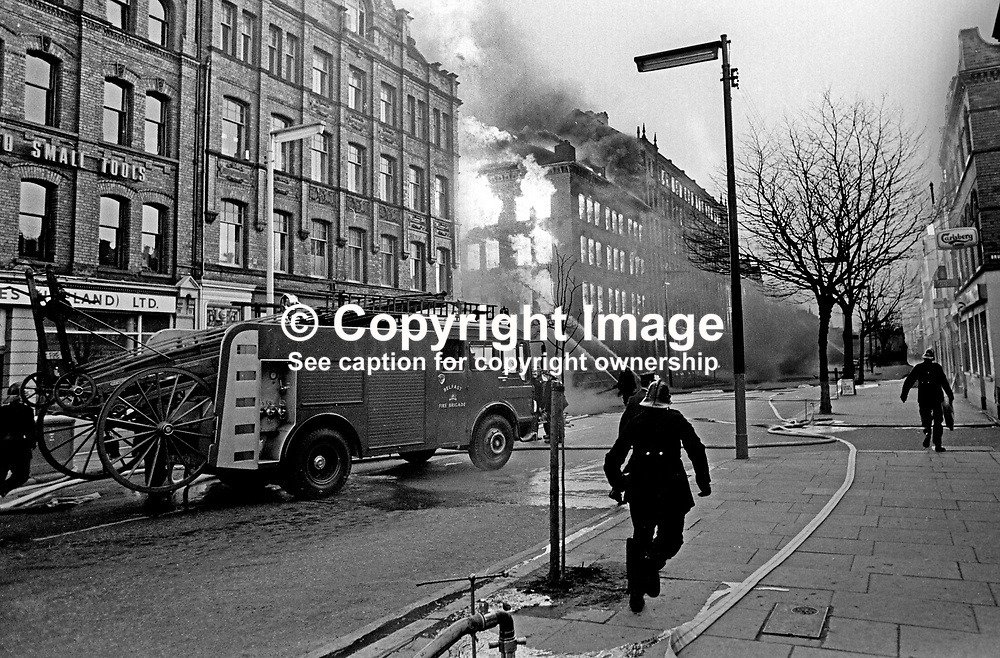 Firemen tackle blaze in Dublin Road, Belfast, N Ireland, following Provisional IRA explosions 6th December 1971. 197112060541a<br /> <br /> Copyright Image from Victor Patterson, Belfast, UK<br /> <br /> t: +44 28 9066 1296 (from Rep of Ireland 048 9066 1296)<br /> m: +44 7802 353836<br /> e: victorpattersonbelfast@gmail.com<br /> <br /> www.images4media.com<br /> <br /> Please see my full Terms and Conditions of Use at https://www.images4media.com/p/terms-conditions - it is IMPORTANT that you familiarise yourself with them.<br /> <br /> Images used online incur an additional cost. This cost should be agreed in writing in advance. Online images must be visibly watermarked i.e. © Victor Patterson or that of the named photographer within the body of the image. The original metadata must not be deleted from images used online.<br /> <br /> This image is only available for the use of the download recipient i.e. television station, newspaper, magazine, book publisher, etc, and must not be passed on to a third party. It is also downloaded on condition that each and every usage is notified within 7 days to victorpattersonbelfast@gmail.com.<br /> <br /> The right of Victor Patterson (or the named photographer) to be identified as the author is asserted in accordance with The Copyright Designs And Patents Act (1988). All moral rights are asserted.